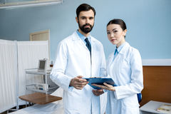 Doctors holding diagnosis Stock Photography