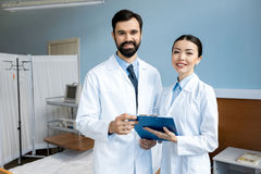 Doctors holding diagnosis Stock Images