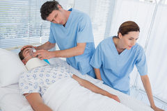 Doctors holding patients oxygen mask Royalty Free Stock Photo