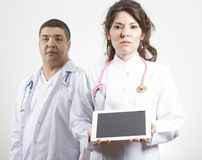 Doctors holding tablet pc stock photos