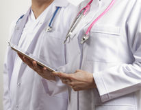 Doctors holding tablet pc royalty free stock images