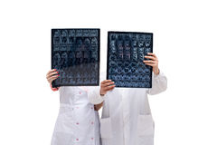 Doctors holding tomograms in front of them Royalty Free Stock Photography
