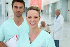 Doctors in hospital hallway Royalty Free Stock Photography