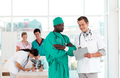 Doctors in a hospital looking after a patient Stock Photos