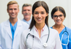 Doctors in hospital. Modern medicine. Group successful doctors in hospital background stock photo