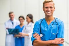Doctors in hospital. Modern medicine. Group successful doctors in hospital background Stock Photo