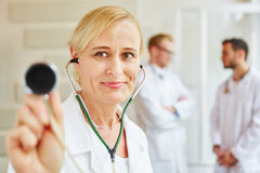 Doctors at hospital. And physician with stethoscope stock images