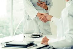 Doctors at hospital working with partner. Healthcare and medical services stock photo