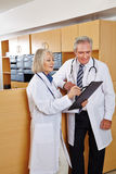 Doctors in hospitel with checklist Stock Photography