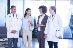 Doctors interacting with colleagues Royalty Free Stock Photos