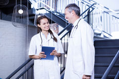 Doctors interacting with each other. In hospital Stock Photography