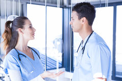 Doctors interacting with each other. In hospital Stock Photos