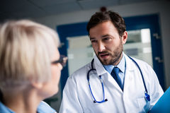 Doctors interacting with each other. In hospital Royalty Free Stock Photography