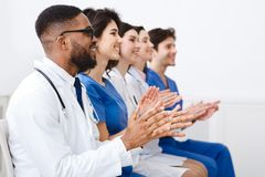 Doctors And Interns Clapping Hands At Conference royalty free stock photography