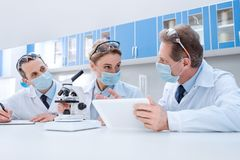 Scientists working with digital tablet Stock Image