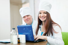 Doctors with laptop in clinic Stock Photography