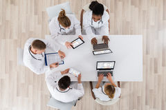 Doctors With Laptop And Digital Tablet In Meeting Royalty Free Stock Photography