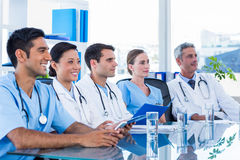 Doctors listening while sitting at a table Royalty Free Stock Photography