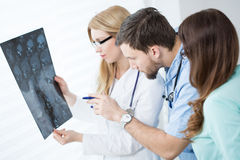 Doctors looking at brain MRI Royalty Free Stock Image