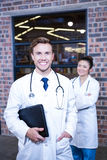 Doctors looking at camera and smiling Royalty Free Stock Photography