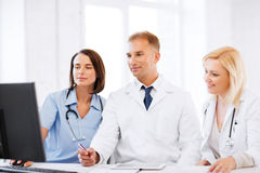 Doctors looking at computer on meeting Royalty Free Stock Photo