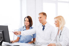 Doctors looking at computer on meeting royalty free stock images