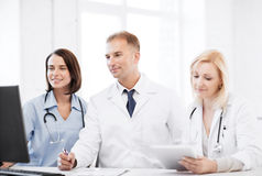 Doctors looking at computer on meeting Stock Images