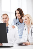 Doctors looking at computer on meeting Royalty Free Stock Photography
