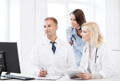 Doctors looking at computer on meeting Stock Photography
