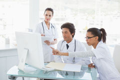 Doctors looking at the computer monitor Royalty Free Stock Photography