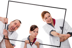 Doctors are looking through a frame Royalty Free Stock Photos
