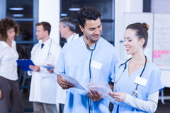 Doctors looking at medical report. And having a discussion Royalty Free Stock Photo