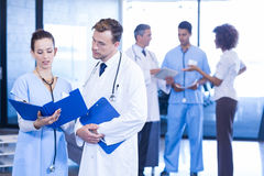Doctors looking at medical report. And having a discussion Royalty Free Stock Images