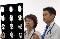 Doctors looking at MRI Stock Photography