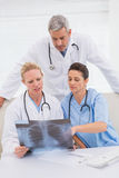 Doctors looking at scans Royalty Free Stock Image