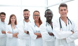 Young doctors looking at camera. Doctors looking and smiling at the camera stock photos