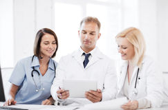 Doctors looking at tablet pc Royalty Free Stock Photo