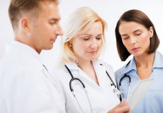 Doctors looking at tablet pc Stock Photography