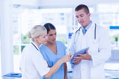 Doctors looking together at tablet Royalty Free Stock Photography