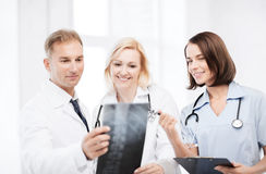 Doctors looking at x-ray Stock Photography