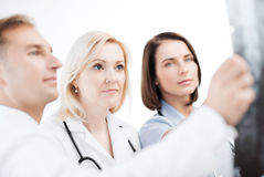Doctors looking at x-ray Stock Images