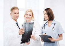 Doctors looking at x-ray Royalty Free Stock Photos