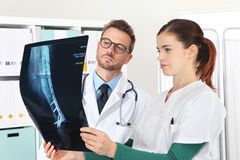 Doctors looking at x-ray in medical office Royalty Free Stock Photography