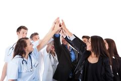 Doctors and managers making high five gesture Stock Image