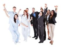 Doctors and managers raising arms Royalty Free Stock Photography