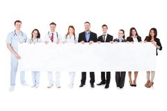 Doctors and managers showing empty banner Stock Images