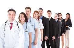 Doctors and managers standing in row Stock Image