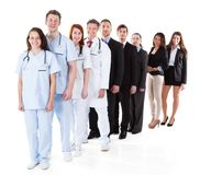 Doctors and managers standing in row Royalty Free Stock Photo