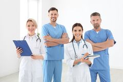 Doctors and medical assistants in clinic. Health care service royalty free stock photos