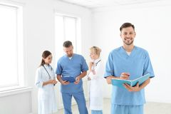 Doctors and medical assistants in clinic. Health care service royalty free stock image